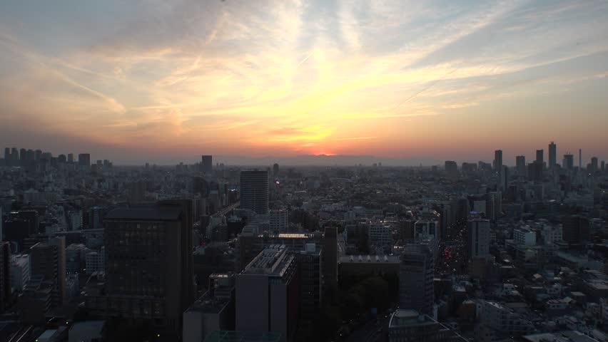 TOKYO,  JAPAN - CIRCA APRIL 2019 : Aerial sunrise view of CITYSCAPE of TOKYO around Shinjuku city and Ikebukuro city.  View from Bunkyo ward.  Time lapse shot.