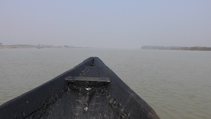 Riding Wooden Longtail  Traditional  Wooden Boat Nose Front View The small fishing boat floats towards open sea as seen from a canoe