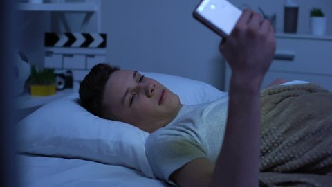Teenager watching adult content on smartphone and masturbating, puberty age