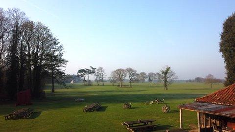 NORFOLK, ENGLAND - APRIL 8, 2019: Pub benches in the garden at The Gunton Arms near Cromer in Norfolk, UK.