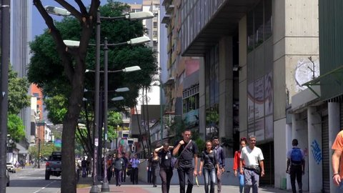 Unidentified people and street traffic in the Chacao district of Caracas, the capital of Venezuela, circa Mach 2019