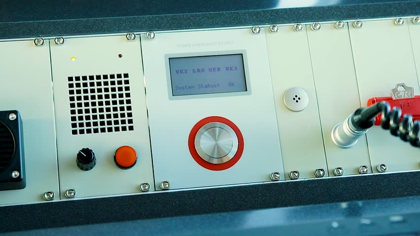 CLOSE UP STATIC SHOT: The Emergency system is activated by pressing the button. The interface shows that the signal is sent to 4 emergency units, each responds and confirms the signal is accepted.