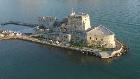 Bourtzi Castle, Slow aerial reveal shot of Town of Nafplio, Greece 4k