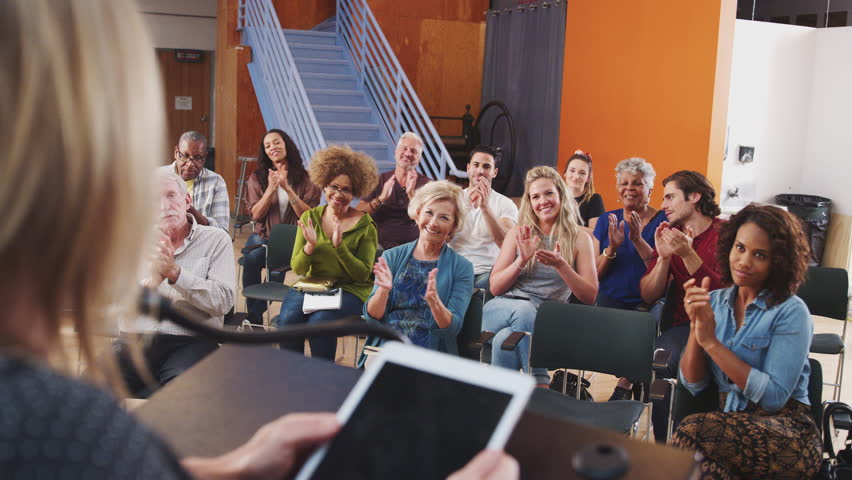 Group Attending Neighborhood Meeting Applauding Speaker In Community Center | Shutterstock HD Video #1028669894