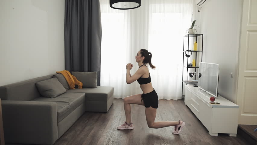 Young woman doing fitness workout for healthy lifestyle at home. Slow motion. Healthy and sport lifestyle. | Shutterstock HD Video #1028721554