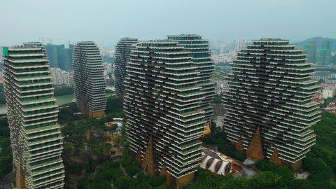 SANYA, CHINA - OCTOBER 7 2018: cityscape famous hotel apartment complex aerial panorama 4k circa october 7 2018 hainan hainan china.