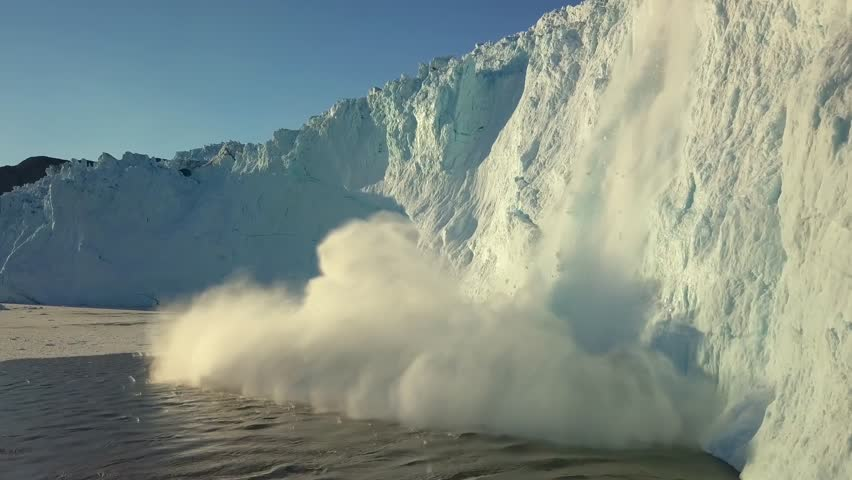 Iceberg and ice from glacier in arctic nature landscape on Greenland. Aerial video drone footage of icebergs in Ilulissat icefjord. Affected by climate change and global warming. | Shutterstock HD Video #1028916404