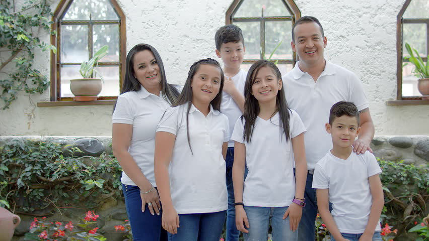 Hispanic family wearing white at home | Shutterstock HD Video #1028995424