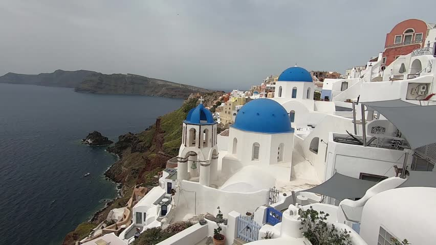 View of the Greek Orthodox Blue Dome Church in Oia. Blue Domed Church in the village of Oia on the Greek Island of Santorini, Greece. | Shutterstock HD Video #1029058724
