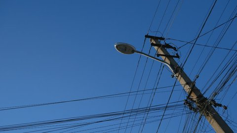 telegraph pole with telephone cables