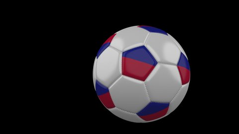 Soccer ball with the flag of Haiti flies past the camera, slow motion, 4k footage with alpha channel
