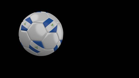 Soccer ball with the flag of Nicaragua flies past the camera, slow motion, 4k footage with alpha channel