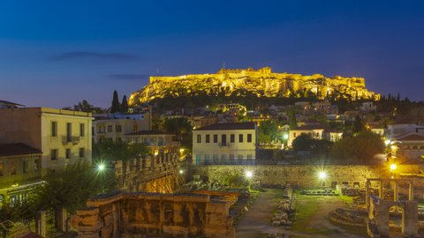 Timelapse 4k, Acropolis Hill with Parthenon of Athens at Colorful Morning and Twilight Time with Aerial rooftop view over the old town Plaka Cityscape of Athens Activities in town, Greece.