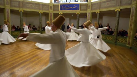 Traditional dances of dervishes in white clothes in Galata Mevlevihanesi. Sufi whirling dervish. Spiritual gift to those witnessing ritual.He spins with the music. TURKEY, Istanbul January 13, 2019