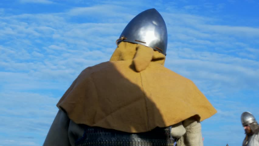 The man in the helmet awaits the start of the fight, Reconstruction of historical times
