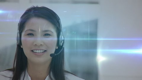 Close up of a female Asian call centre agent talking to a client. Digital animation of profile icons connected by lines are seen in the foreground