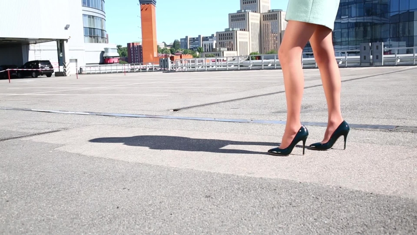 Closeup womans beautiful legs in fashionable heel shoes outdoors. woman makes a few steps forward and back, FullHD stock footage | Shutterstock HD Video #1029448844