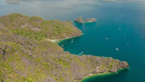 aerial view of bay and the tropical islands. Seascape with tropical rocky islands, sea blue water. islands and mountains covered with tropical forest. El nido, Philippines, Palawan. Tropical Mountain