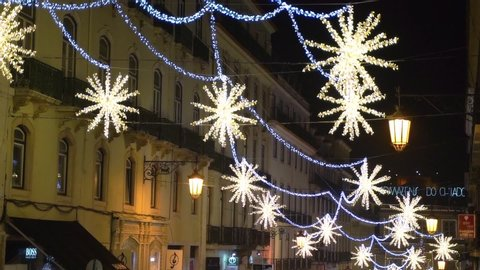 Lisbon, Portugal - 12/26/18: Yellow stars, Christmas decorations downtown