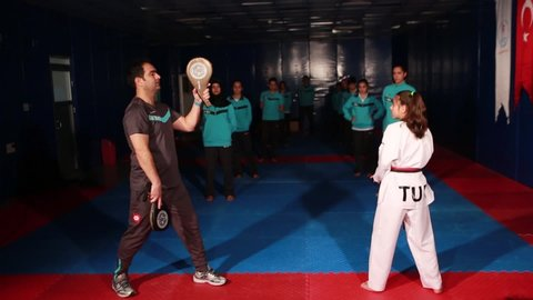 Adult trainer is training teenagers in karate class/Kayseri,TURKEY 01.03.2016