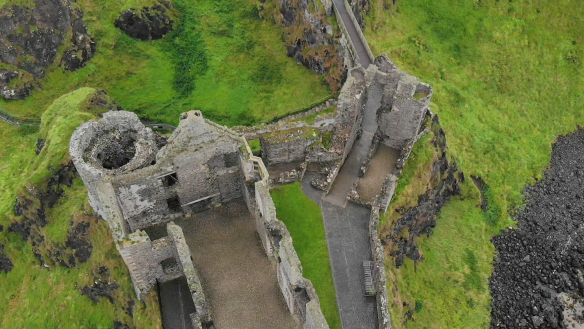 Bird's eye view shot with descending drone in the middle of medieval castle ruins | Shutterstock HD Video #1029673034