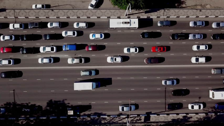 Drone's Eye View - Aerial top down view of road cars and trucks | Shutterstock HD Video #1029734954