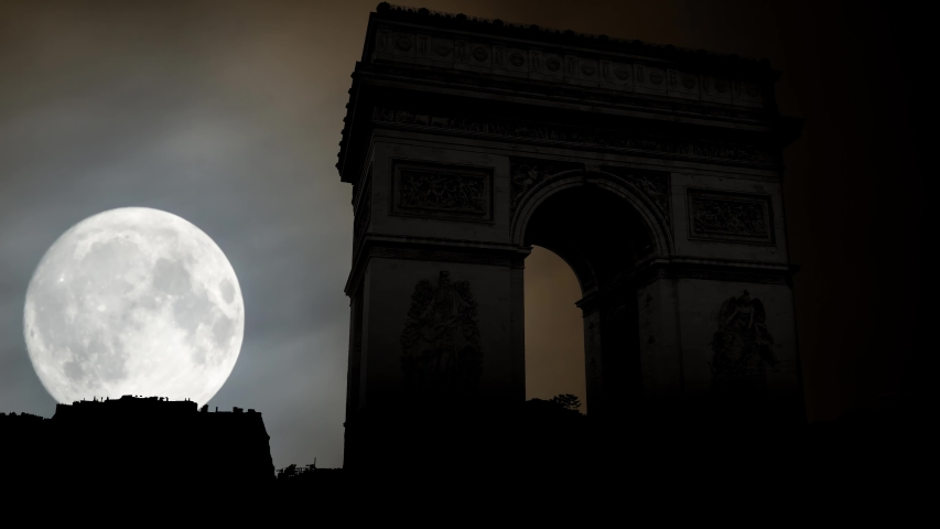 The Arc de Triomphe de l'Etoile or Triumphal Arch of the Star: Time Lapse by Night with Full Moon, Paris, France | Shutterstock HD Video #1029821234