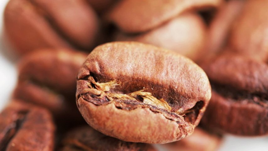 Macro shot of coffee beans. Selective focus. Medium roast. Camera locked down.   Shutterstock HD Video #1029865634