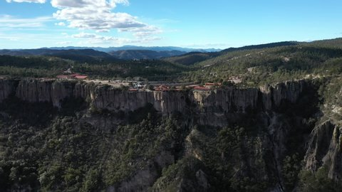 Aerial drone view of the Chepe Train at the station of Divisadero in Copper Canyon, Chihuahua, Mexico