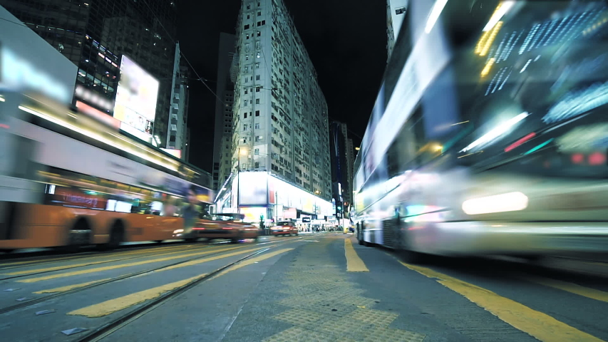 Street Traffic In Hong Kong At Night. Very busy road in the central district in rush hour. Timelapse | Shutterstock HD Video #1029987014
