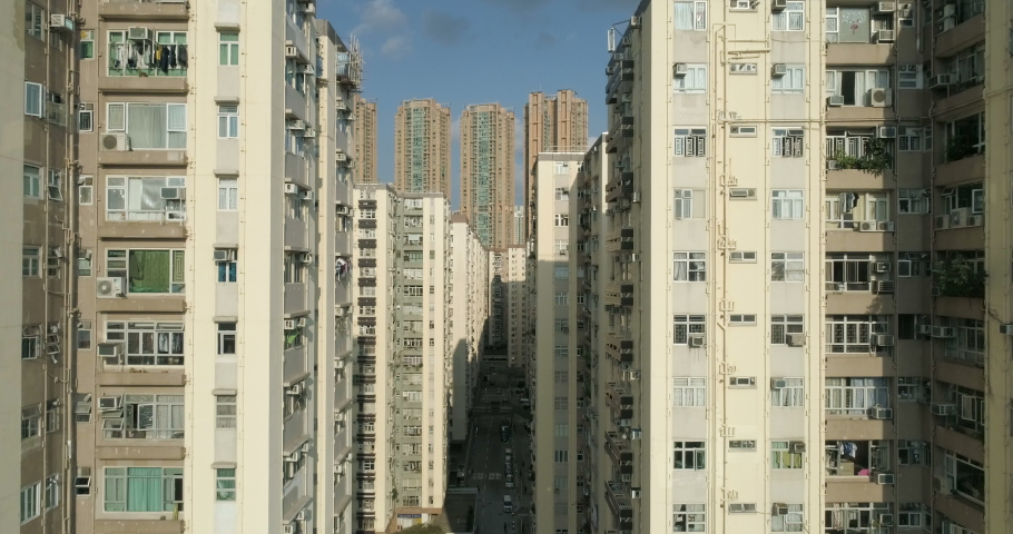 Drone descend between the buildings of residential area of Hong Kong. The contrast between the modern and old housing stock of a large metropolis. Real estate market. Urban district cityscape 4K | Shutterstock HD Video #1029987044