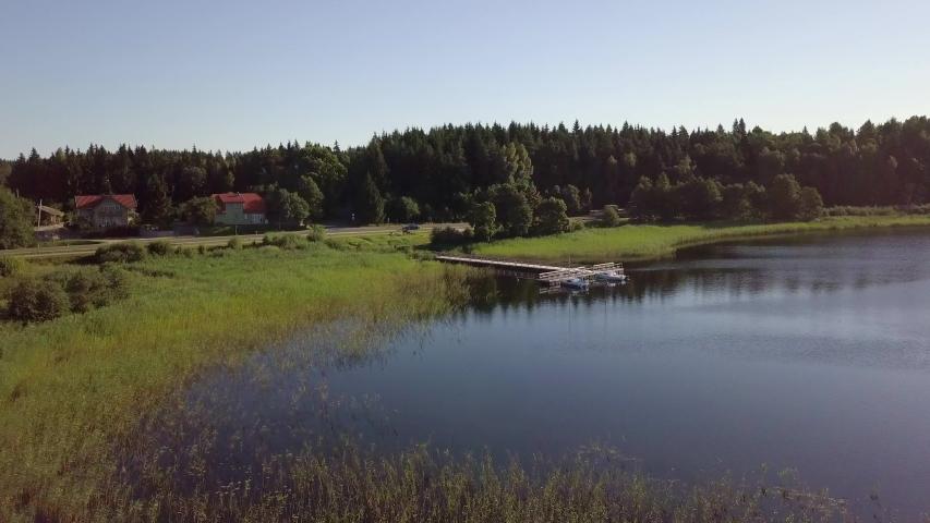 Flight over Lake Plateliai (Plateliu ežers). Aerial of sailing yacht quay in Zemaitija National Park, Samogitia, Lithuania | Shutterstock HD Video #1030083284