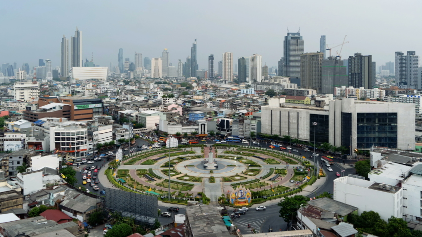 Time lapse of Wongwian Yai roundabout. Aerial view of highway junctions. Roads shape circle in structure of architecture and technology transportation concept. Urban city, Bangkok Downtown, Thailand. | Shutterstock HD Video #1030084574
