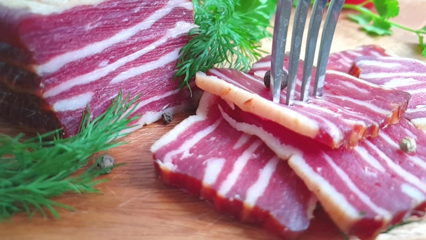 Take bacon with a fork, slow motion   Shutterstock HD Video #1030098494