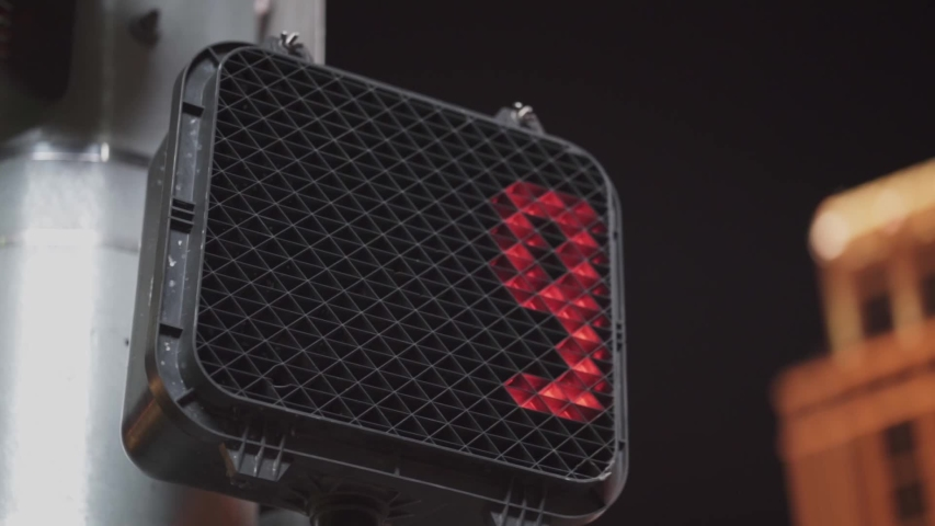 Slow motion close-up shot of a pedrestrian street light counting down during night time. | Shutterstock HD Video #1030125464