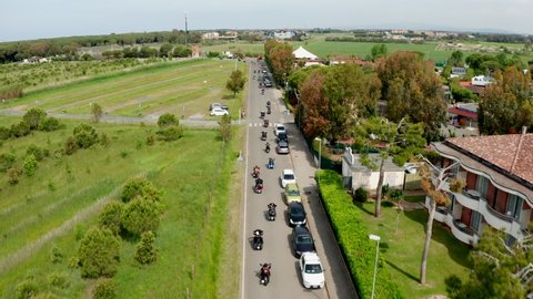Aerial view of group of Harley-Davidson motor bikers traveling on the road