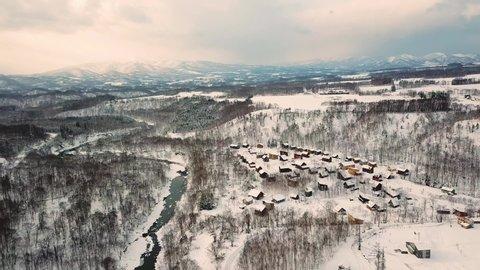 Aerial shot of snow village in winter, Niseko, Hokkaido, Japan