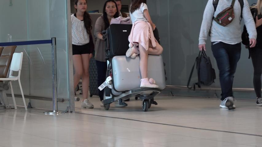 BANGKOK, THAILAND - MAY 26, 2019: Passengers arrive at check-in counters at Suvarnabhumi Airport, Bangkok, Thailand. Suvarnabhumi Airport it one of the biggest international airports in Southeast Asia | Shutterstock HD Video #1030329704