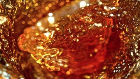 Super Slow Motion Shot of Ice Tea Vortex at 1000 fps.