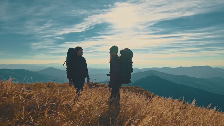 The man and woman greeting on the picturesque mountain. slow motion | Shutterstock HD Video #1030416134
