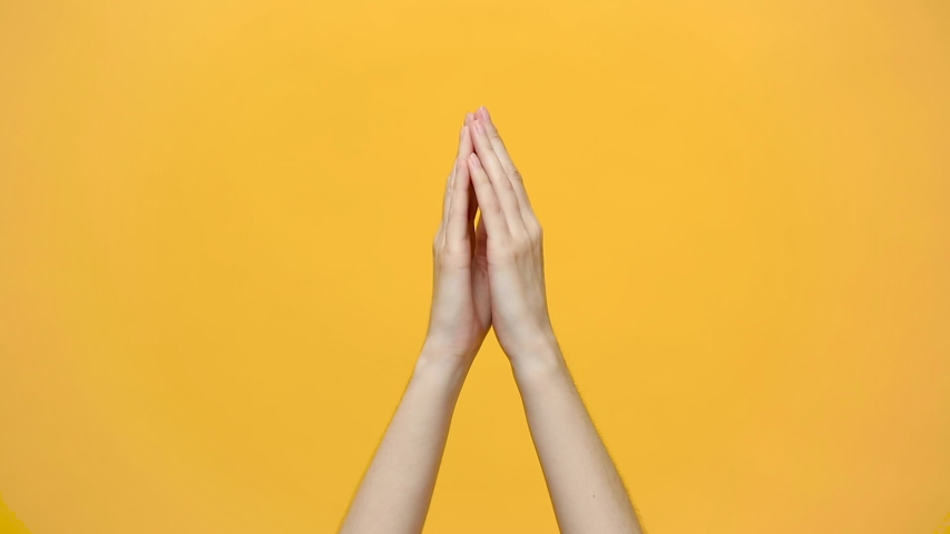 Woman hands clapping applause and showing two thumbs up gesture isolated over yellow background in studio. Copy space for advertisement. With place for text or image. Advertising area, mock up.  | Shutterstock HD Video #1030489484