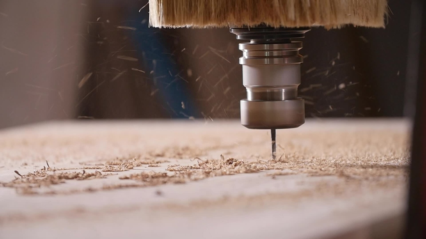 Concept of production and woodworking. Cutting wood with a CNC milling machines | Shutterstock HD Video #1030564424