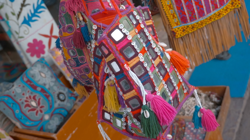 Indian traditional colorful national ladies' handbags flutter in the wind attracting tourists to buy in the city of Pushkar, India   Shutterstock HD Video #1030571654