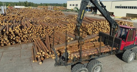 Truck with a manipulator loads logs, Truck for transporting logs with a manipulator. Modern equipment at woodworking factory