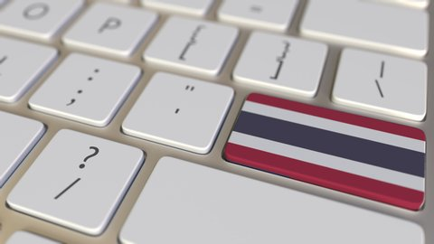 Key with flag of Thailand on the computer keyboard switches to key with flag of the USA, translation or relocation related animation