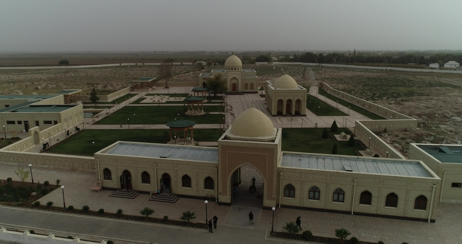 View of the ancient castle in the Sands of Uzbekistan. Beautiful architecture of the East. The vast sandy expanse. Flying a copter | Shutterstock HD Video #1030805324