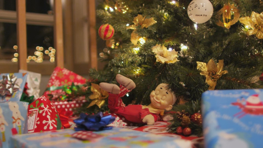 Dolly across presents and christmas tree | Shutterstock HD Video #1030829144