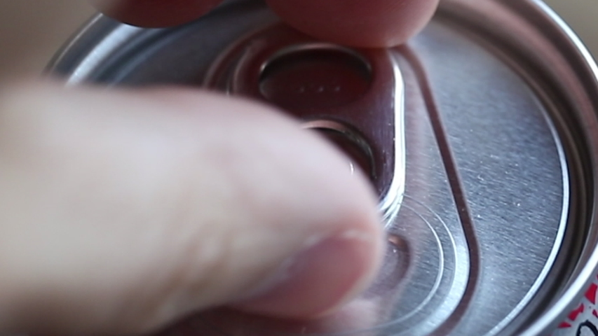 Opening a aluminium can cap filled with an energy drink or beer. | Shutterstock HD Video #1030836674