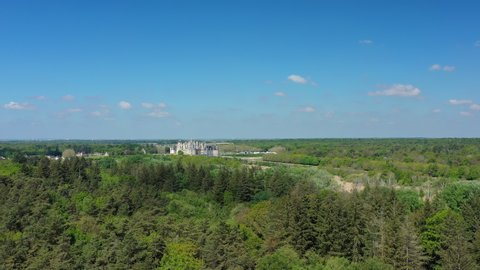Aerial view of Chambord Castle (Chateau Chambord), picturesque castle in Loire Valley built in French Renaissance style, state owned property - landscape panorama of France from above, Europe