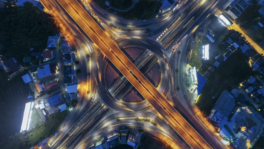 Hyperlapse timelapse of night city traffic on 4-way stop street intersection circle roundabout in bangkok at night, thailand. 4K UHD horizontal aerial view. | Shutterstock HD Video #1030883564